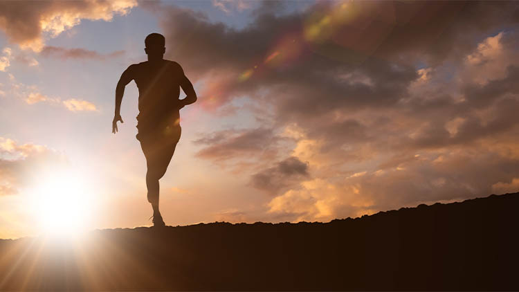 Composite image of fit man running against white background
