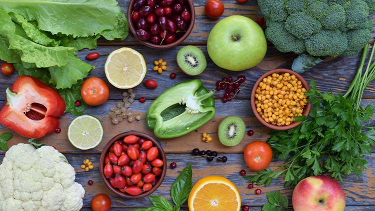 Composition of products containing ascorbic acid, vitamin C - citrus, cauliflower, broccoli, sweet pepper, kiwi, dog rose, tomatoes, apple, currant, sea buckthorn, dogwood. Top view. Flat lay.