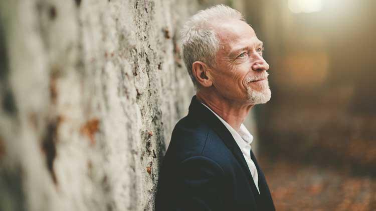 Portrait of handsome mature man, light effect