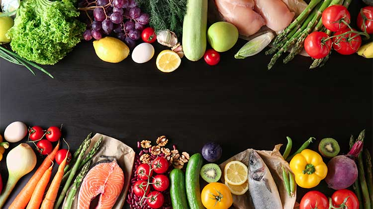 Various healthy products on dark background