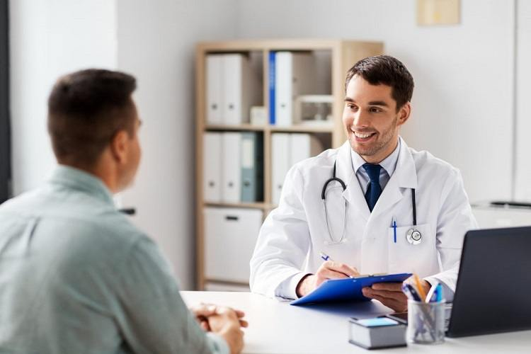 Health professional consulting with patient
