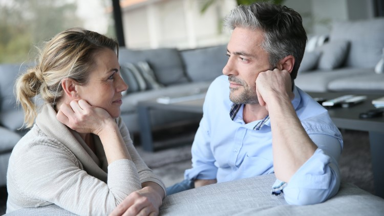 Mature couple gazing into each others eyes