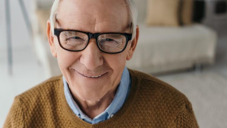 Senior smiling man wearing glasses