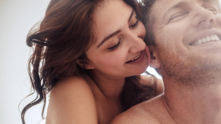 Sensual couple smiling together