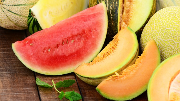 Sliced open melons on table