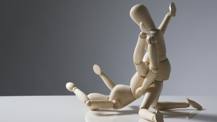 Wooden mannequin imitating sexual position